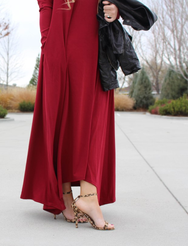 Red long sleeve floor length dress styled with strappy leopard print heels and a leather jacket.